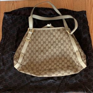 Very well loved and used Gucci satchel